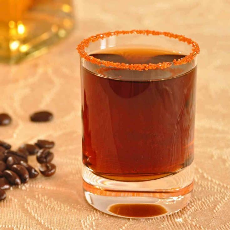 The Alice in Wonderland cocktail is a Mexican-inspired shot drink made with tequila, coffee liqueur and triple sec. #tequilashots #tequilacocktails #kahluacoctails
