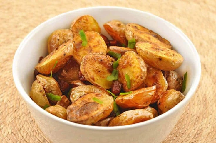 Smoked paprika and crispy bits of andouille sausage add robust flavor to this easy-to-make, roasted potato side dish. #roastedpotatoes #andouillesausage