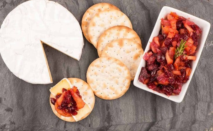 Perfect for serving with soft, ripe cheeses like camembert or brie, or a sharp cheddar this fruity chutney is easy to prepare and full of flavor. #appetizer #applechutney #cranberrychutney