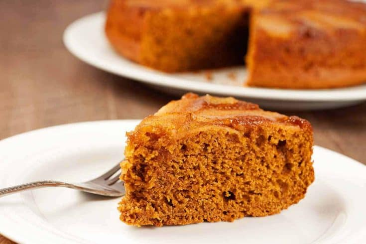 This moist and easy gingerbread cake recipe is richly flavored with molasses, ginger and cinnamon and topped with a layer of buttery apples and brown sugar. #applecake #gingerbread #upsidedowncake