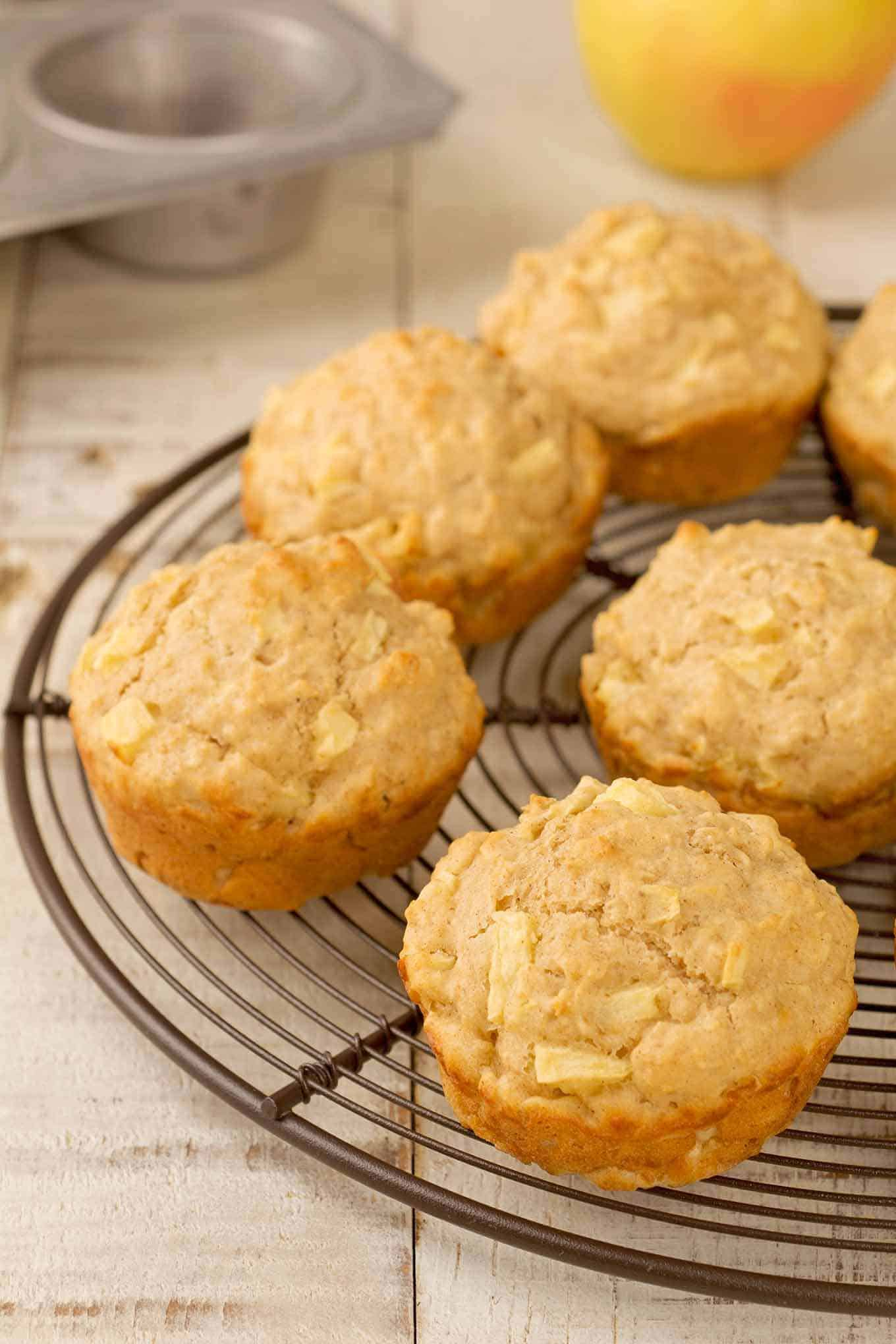 Apple oatmeal muffins on a cooling rack