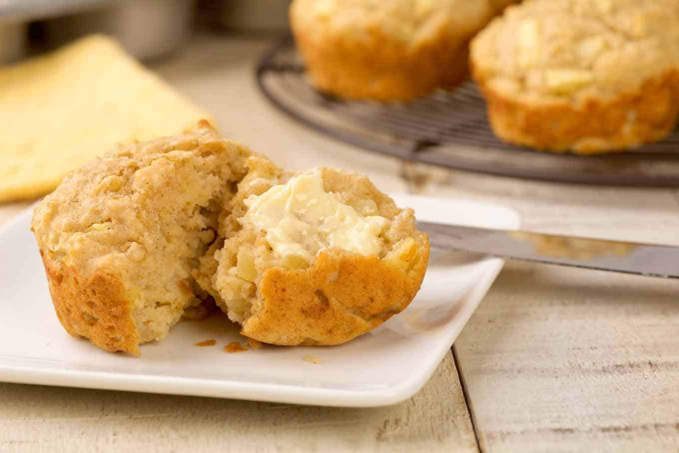 Apple oatmeal muffin cut and spread with butter