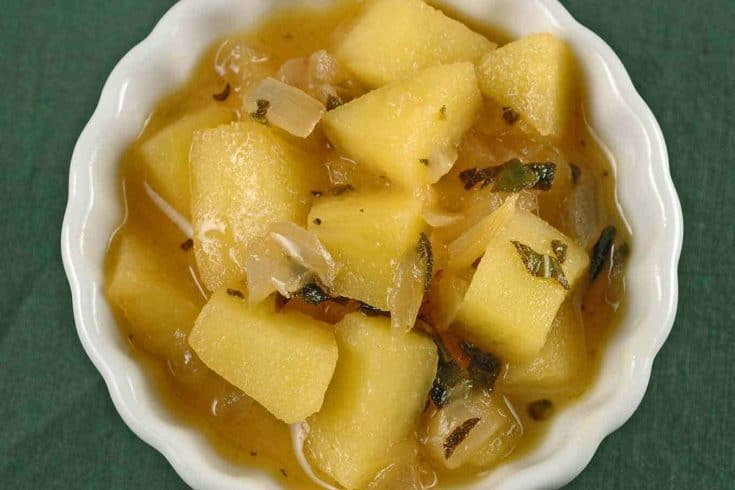 This compote is made with apple cider, dry riesling, fresh sage and chopped apples. The combination is a wonderful accompaniment to roasted poultry, pork and ham.