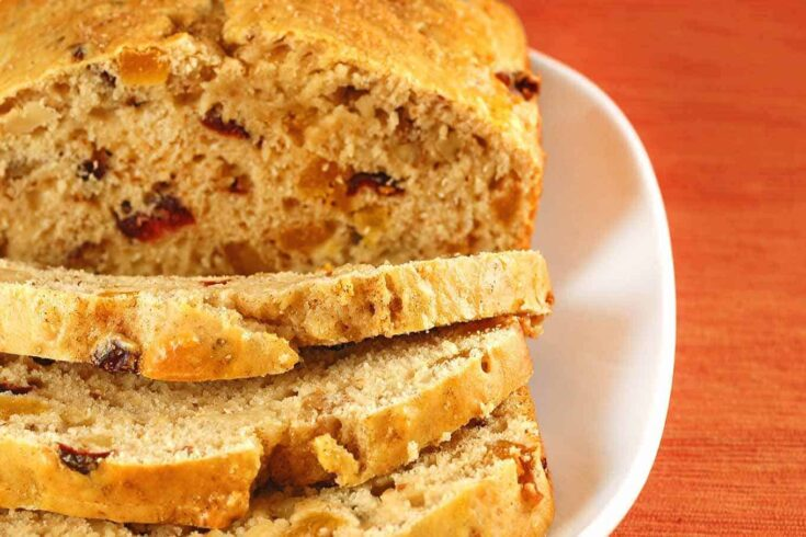 The combination of dried apricots, cranberries and chopped walnuts are tasty additions to this classic quick bread recipe. #cranberrynutbread #nutbread #quickbreadrecipes