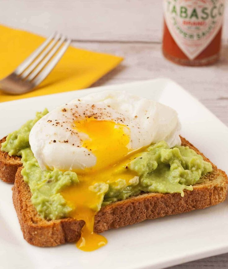 Whole wheat toast topped with lightly-seasoned, mashed avocado and a poached egg makes a delicious, satisfying breakfast. #avocadotoast #breakfast