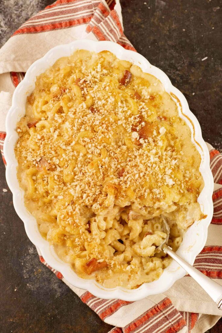 Bits of crispy bacon and sweet caramelized onions combine with Gruyere and fontina cheeses to make an incredibly satisfying baked macaroni and cheese casserole. #macandcheese #macaroniandcheese #bacon