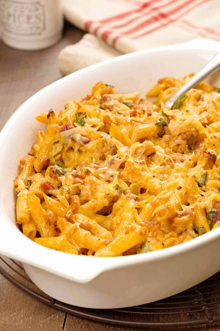 Bite-sized chunks of chicken in a light barbecue-style sauce combine with pasta, bacon, creamy melted gouda, and a bit fresh cilantro to make this flavorful baked pasta casserole. #barbecuechicken #pasta #chicken