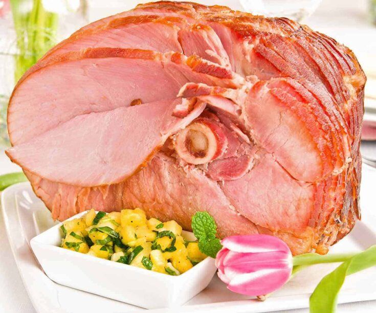 A moist, juicy baked ham served with a tangy chutney made with pineapple, honey, and fresh mint makes an easy main dish for company. #bakedham #pineapplechutney