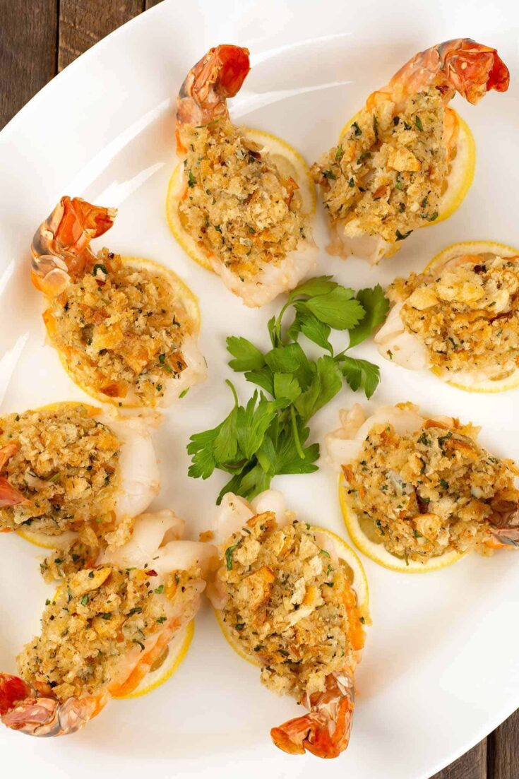 Baked stuffed shrimp is a popular restaurant dish that's easy to make at home and makes a great choice for a special occasion meal. #shrimp #stuffedshrimp #seafood