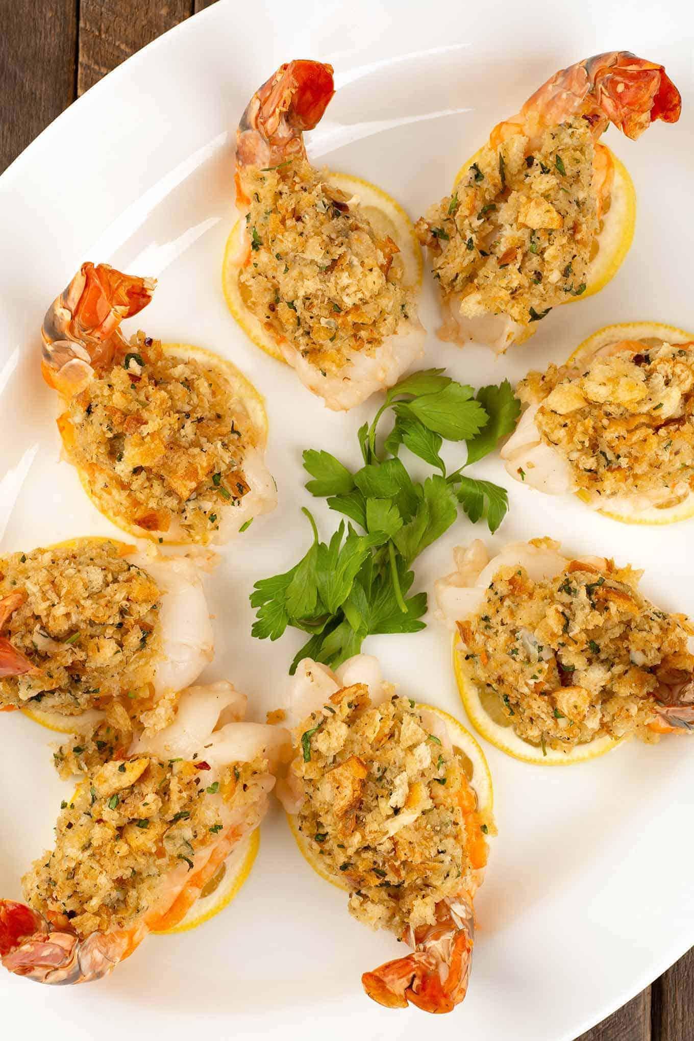 Baked stuffed shrimp on an oval platter