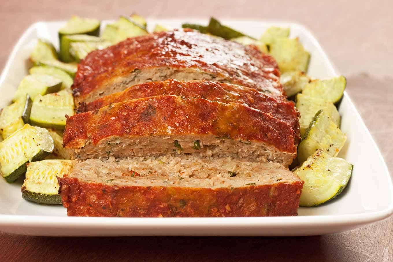 Slices of balsamic and basil turkey meatloaf on a serving platter.