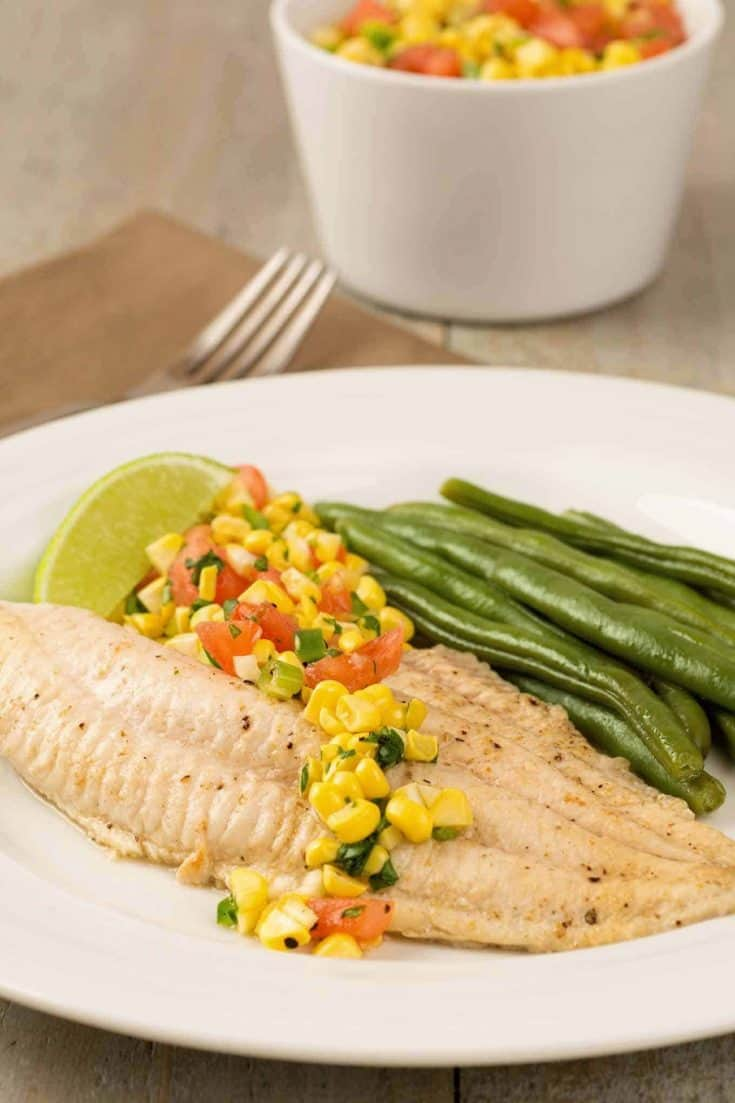 Broiled catfish fillets, topped with a fresh corn salsa make a light satisfying dinner that can be on the table in less than 30 minutes. #maindish #fishdinner #easyrecipe #quickrecipe #fish