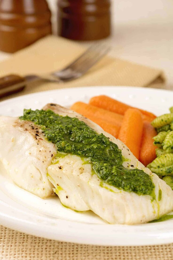 This fool-proof recipe for halibut pairs broiled fillets with a zesty variation on a classic pesto made with fresh kale. #broiledfish #halibut #kale #pesto