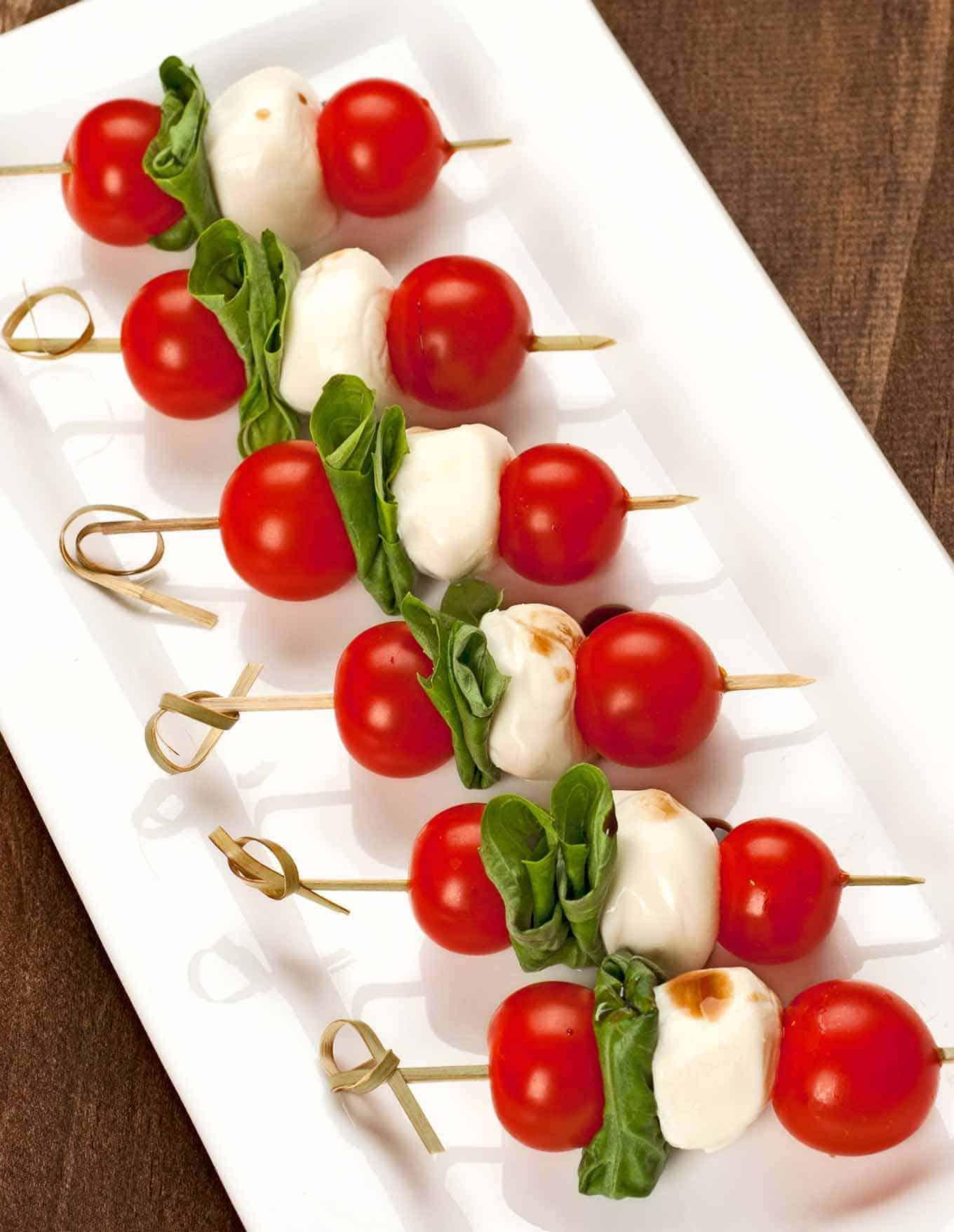 Caprese salad skewers on serving plate