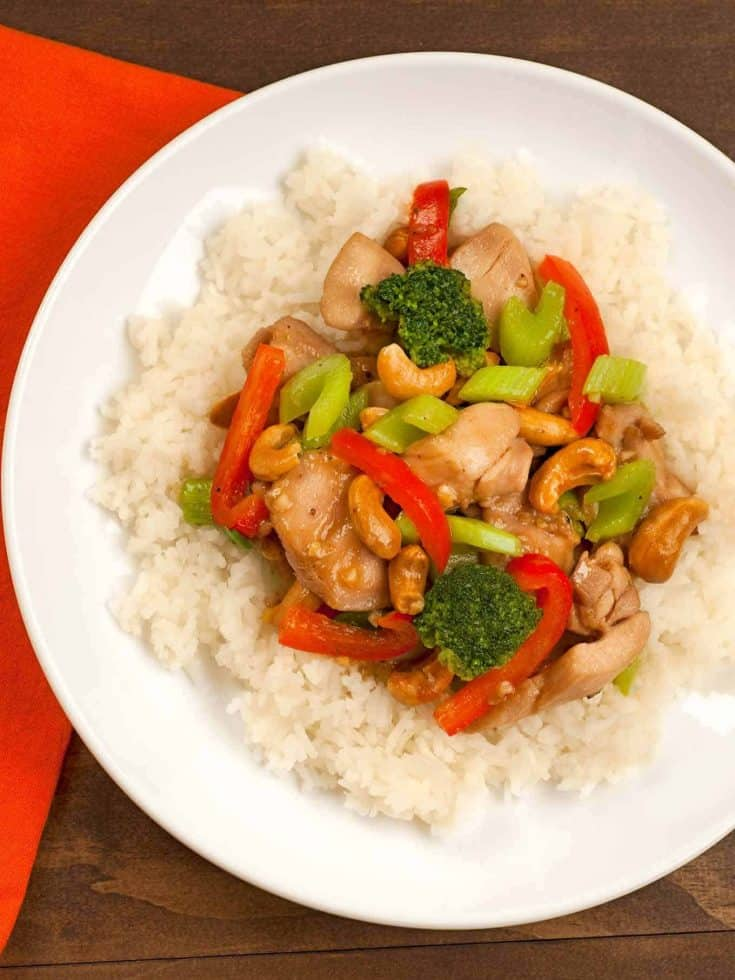 Our healthy, homemade Chinese cashew chicken is quick-to-fix and includes broccoli, red bell pepper, celery and a delicious sauce to serve over steamed rice. #cashewchicken #chickenstirfry