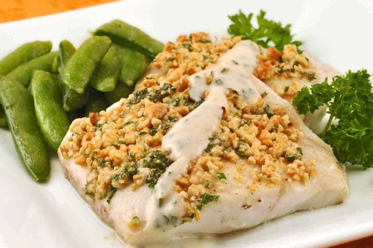 Chopped cashews, fresh parsley and chives make a delicious, crunchy crust for delicate, baked flounder fillets.