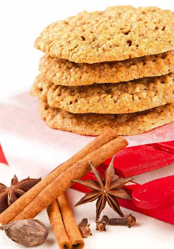 Classic chai spices like cinnamon, cardamom, cloves, and ginger add layers of flavor to this simple recipe for oatmeal cookies. #spicecookies #christmascookies #oatmealcookies