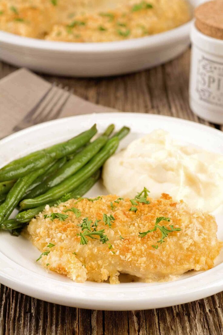 These tender, boneless chicken breasts are smothered in a blend of Dijon mustard, white wine and cream, topped with cheese and panko, and baked until golden and bubbly. #chickendinner #chickendijon #maindish