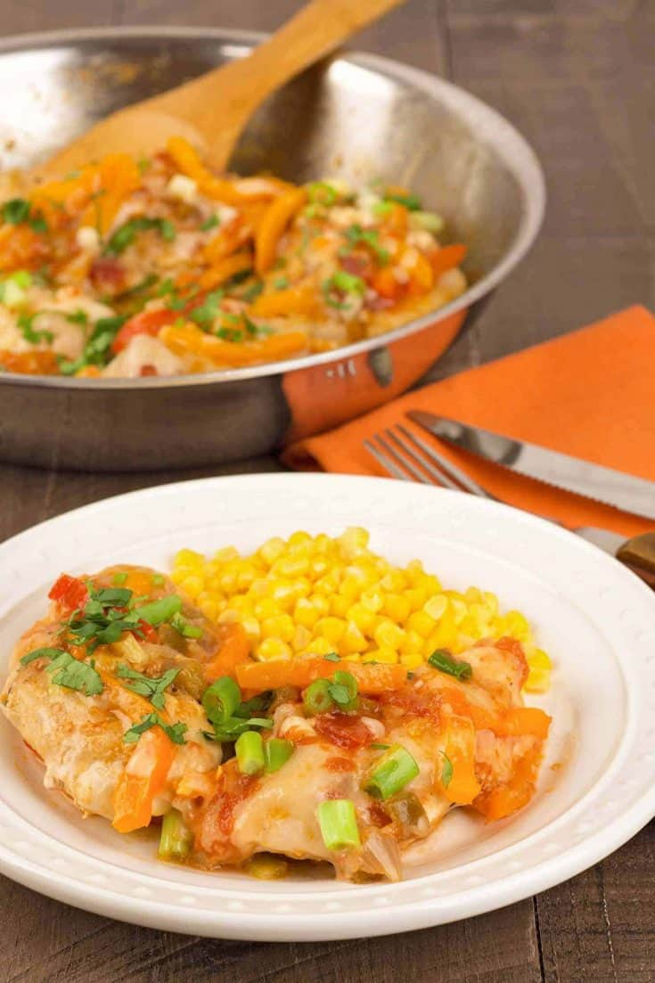 Tender chicken breasts topped with salsa, sautéed sweet bell pepper and melted cheese make a fast and easy chicken skillet dinner filled with flavor. #chicken #skilletdinner