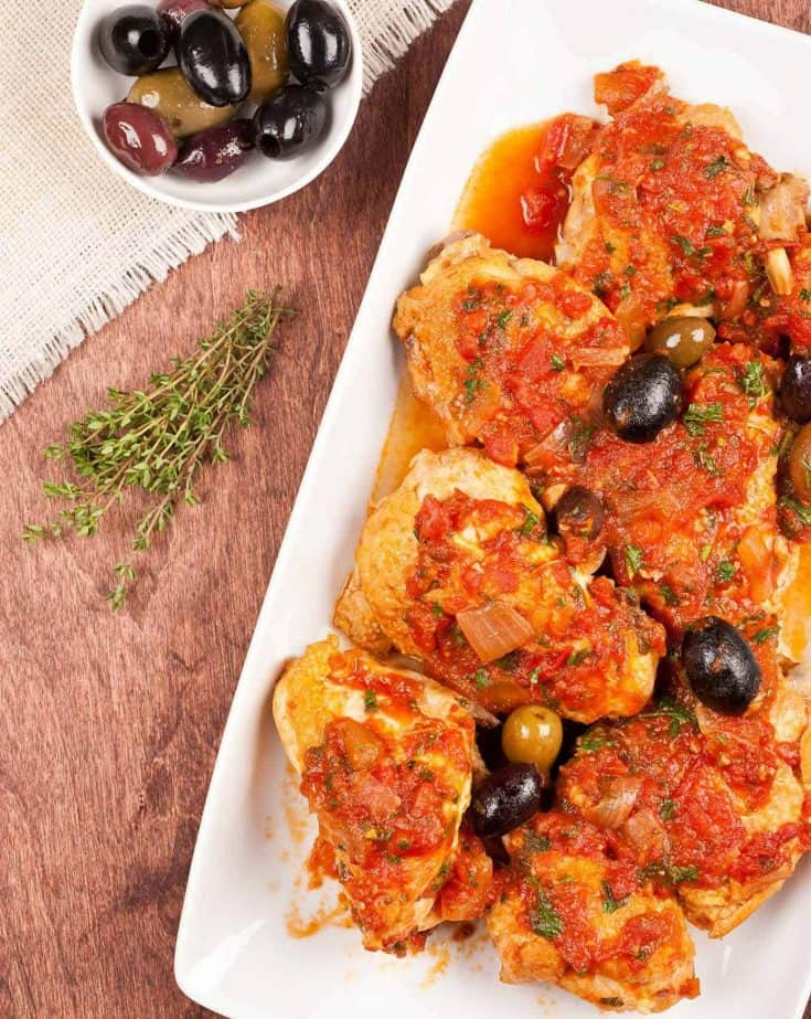 Chicken Cacciatore, or Hunter-Style Chicken is a simple, peasant-style combination of chicken flavored with onion and garlic and simmered in a light, white wine and tomato sauce. #italianrecipe #chickendish #olives #tomatoes