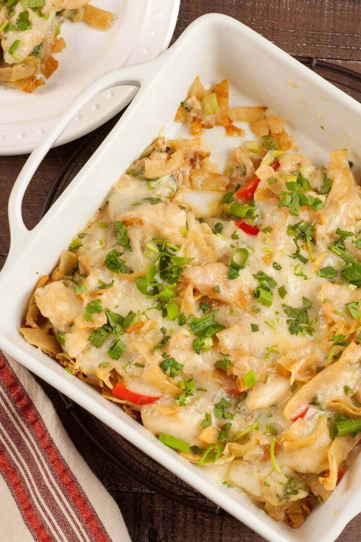 This tasty variation on traditional Mexican chilaquiles combines layers of fried corn tortilla strips with chicken simmered in a creamy, cilantro-lime sauce and a topping of melted Monterey Jack cheese. #mexicanrecipe #chickencasserole #tortilla