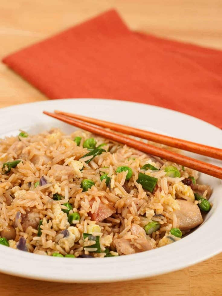 Fried rice is a quick, easy dish to make at home, provided you have cooked your rice in advance. This recipe uses boneless chicken thighs, but pork or shrimp would be equally delicious. #friedrice #chineserecipe