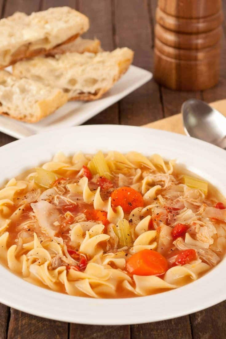 Our recipe for chicken noodle soup is a family favorite made with egg noodles, vegetables, and stock made from oven-roasted chicken legs. #chickensouprecipe #chickennoodlesoup #homemadechickensoup