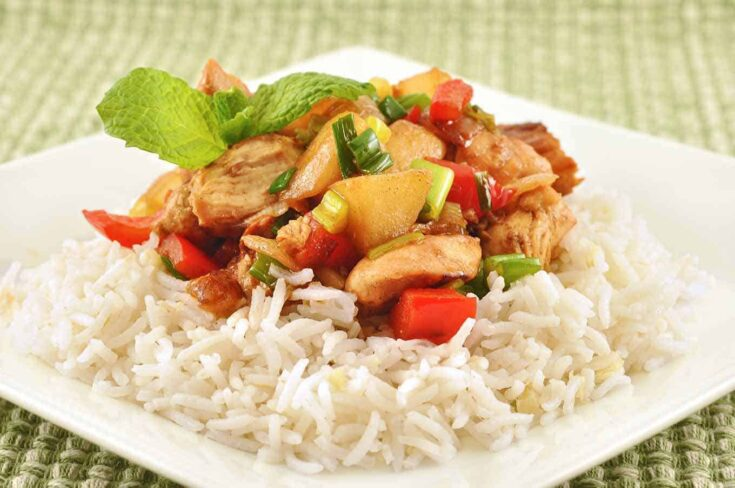 This is a quick-to-fix dish of sautéed chicken, red bell pepper and chunks of fresh pear tossed in a lightly spiced rum sauce. #chickenbreastrecipes #chickenrecipes