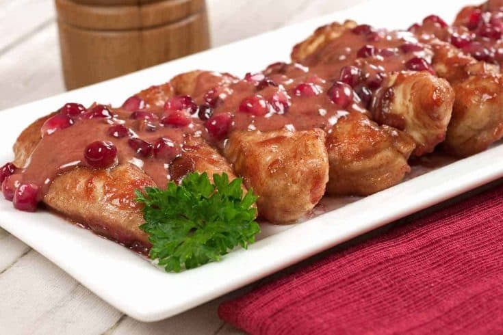 Ordinary chicken tenderloins turn into an elegant dish when sauced with a blend of pomegranate, fresh ginger, and cream. #chickenrecipes #chickenwithpomegranatesauce