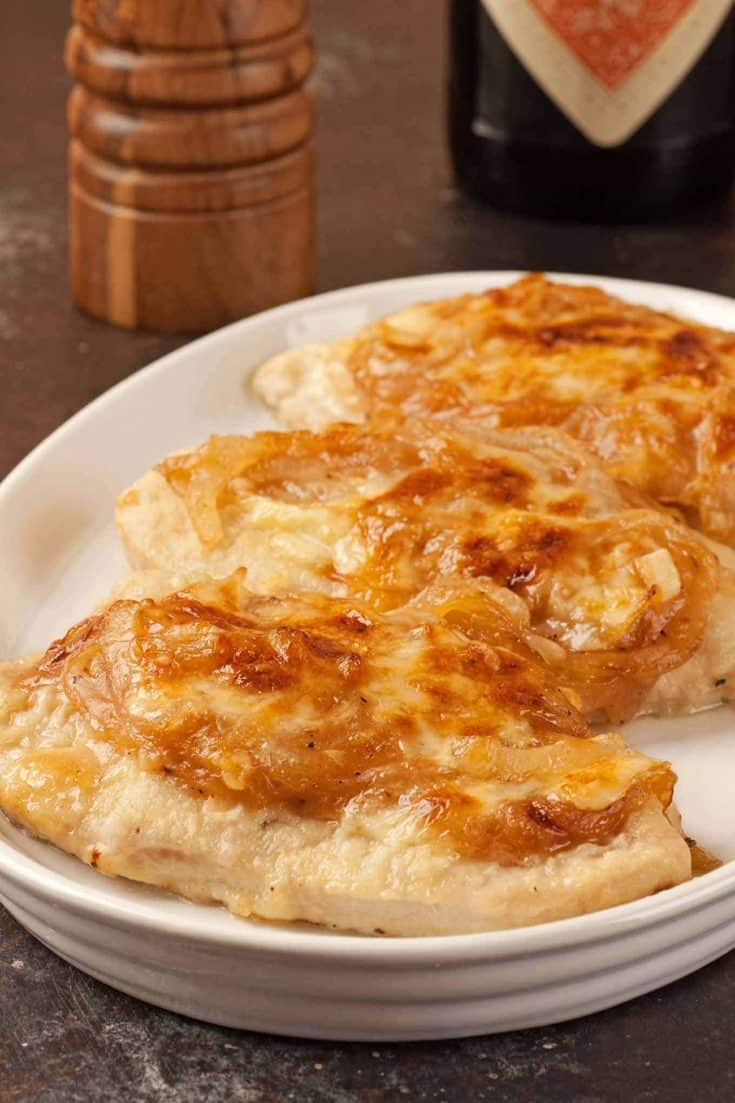 This easy recipe for boneless chicken breasts uses a topping of sherry-glazed caramelized onions and melted Muenster cheese to keep them moist and tender. #chickenrecipes #chickenwithsherry