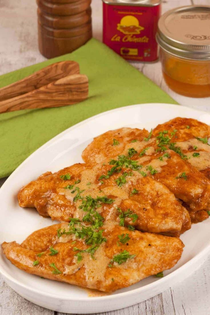 Smoked paprika, honey and a bit of cream combine to make a sweet and smoky pan sauce for ordinary boneless chicken breasts. #chickenrecipes #chickenbreasts