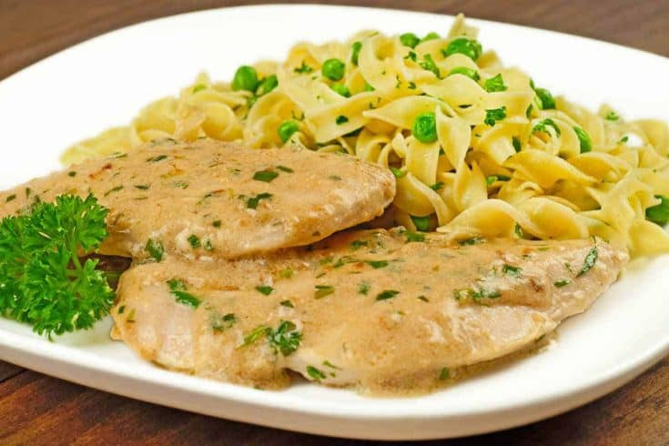 This is a simple dish of sautéed chicken breasts, in a light and creamy, white wine pan sauce flavored with fresh tarragon. #chickenrecipes #chickenbreastrecipes