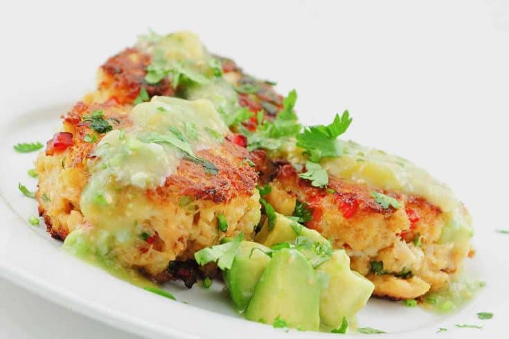 These Mexican-inspired crab cakes are flavored with chipotle chilis and topped with a sauce of tomatillos and avocado.