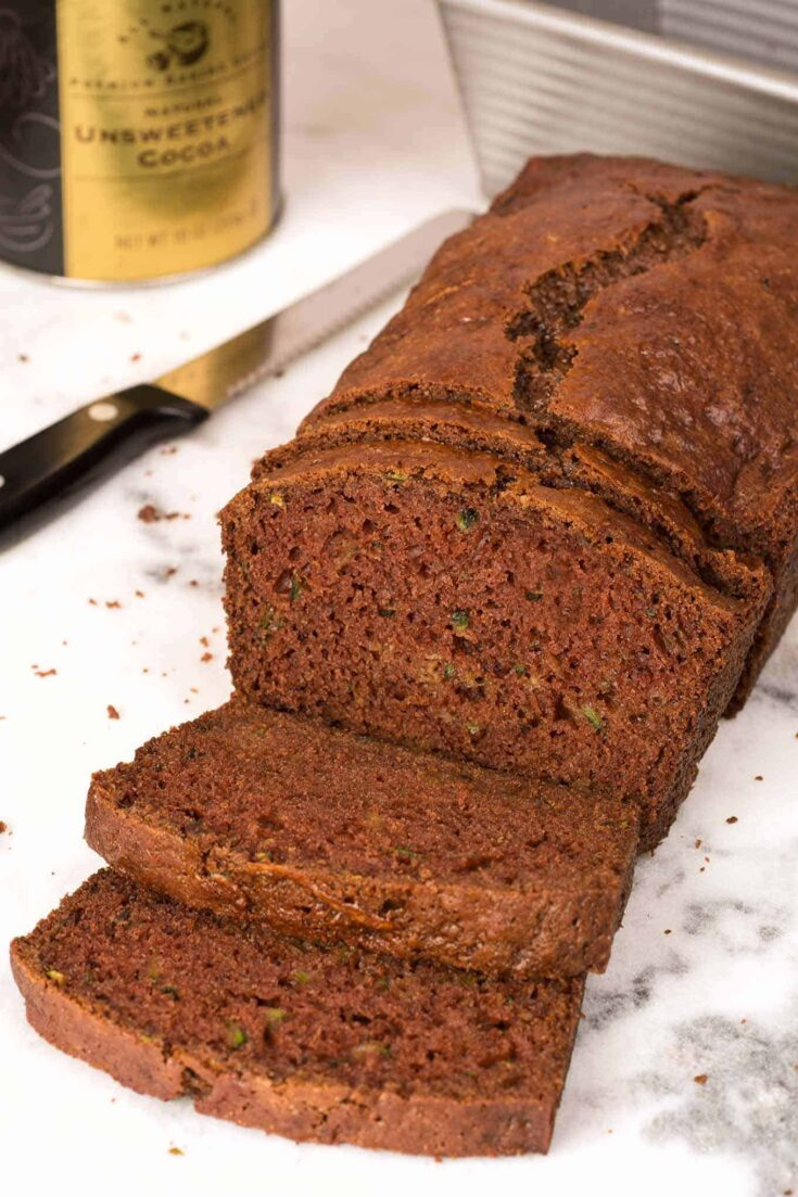 Baked with buttermilk and shredded zucchini, our chocolate zucchini bread is a great way to satisfy your sweet tooth without a lot of fat and calories. #quickbread #chocolatezucchinibread #chocolatebread