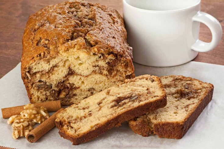 A flavorful combination of cinnamon, chopped walnuts and butter is swirled through the batter of this moist, delicious quick bread. #quickbread #cinnamonbread