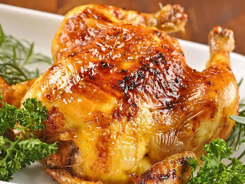 Closeup of a whole glazed Cornish hen.