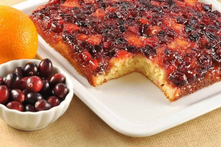 A flavorful combination of tart cranberries and sweet oranges make this Cranberry Upside-Down cake the perfect ending for a holiday dinner. #holidaydesserts #cranberryupsidedowncake #cranberrycake #christmasdessert