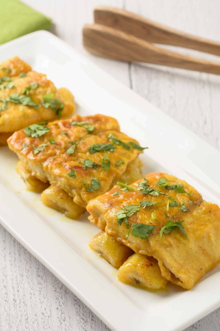 This simple recipe for curried fish with bananas is quick to prepare and has the perfect blend of fragrant, sweet and buttery flavors. #fish #curryrecipe #tilapia #barramundi
