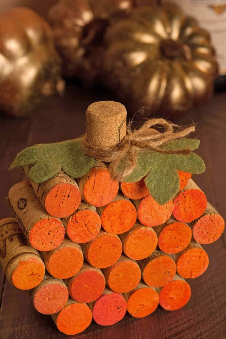 All you need is a little paint, hot glue, felt and a piece of twine to recycle some old wine corks into a cute fall table decoration that will last for years. #winecorkpumpkin #winecorkcrafts #falltabledecor
