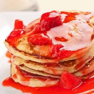Fluffy Ricotta Pancakes with Strawberry-Orange Sauce