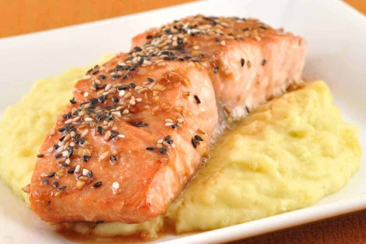 These Glazed Sesame Salmon fillets are flavored with soy sauce, honey, garlic, and ginger, oven-roasted and served with Wasabi Mashed Potatoes. #salmonrecipes #glazedsalmon #sesamesalmon #wasabimashedpotatoes