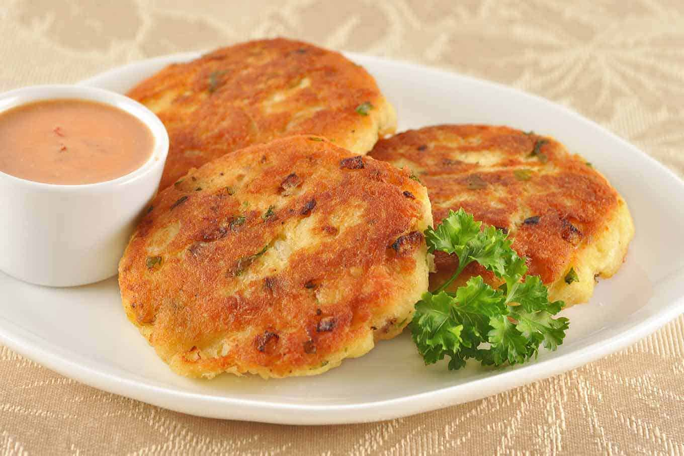 Golden fish patties with chipotle orange dipping sauce for Baked fish cakes