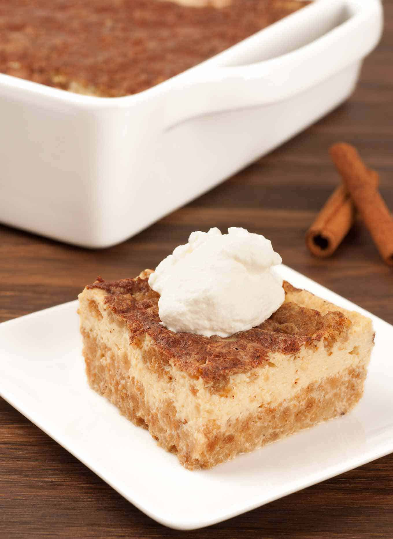 A thick slice of Grape Nut pudding showing the soft cereal crust on the bottom and creamy custard layer on top.
