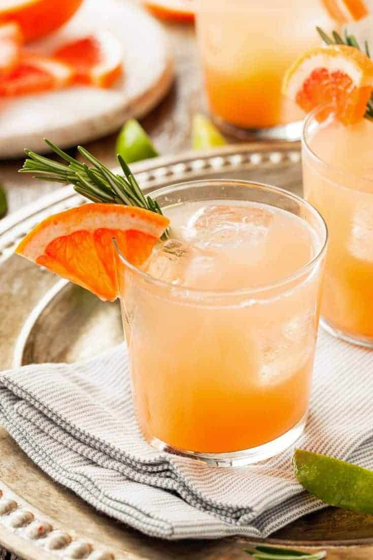The perfect choice for citrus lovers everywhere, this refreshing variation on a margarMade with tequila and fresh-squeezed juices, this grapefruit margarita on the rocks is a refreshingly easy twist on a classic. #grapefruitcocktail #cocktailrecipes #tequilacocktails #grapefruitmargarita