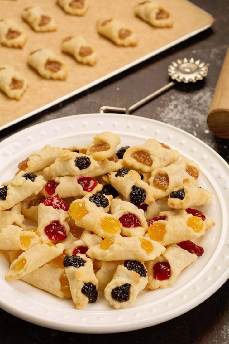 Kiffles (kiflis) are traditional Hungarian cream cheese pastry cookies with assorted fruit and nut fillings like apricot, raspberry, almond, and poppyseed. #hungariankiffles #kiffles #kiflis #hungariancookies #christmascookies