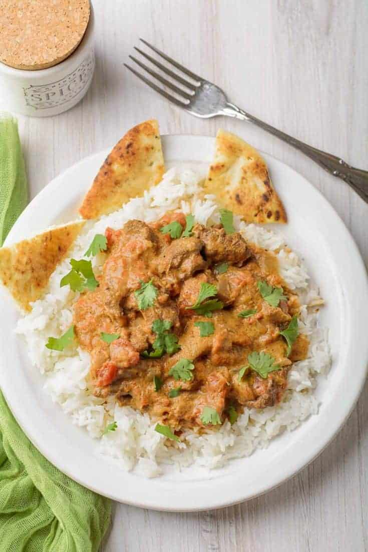 Chicken Tikka Masala is a simple, mild curry dish made with tender chunks of boneless chicken thighs, tomatoes, Indian-inspired spices, yogurt and cream. #chicken #chickentikkamasala #chickenthighs