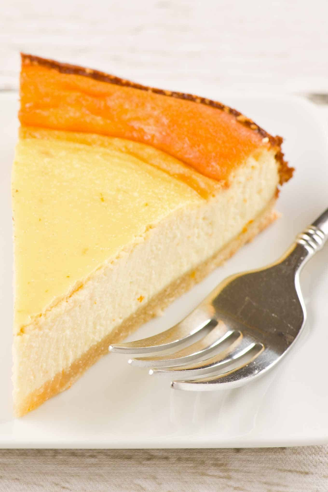 Single slice of ricotta pie on a dessert plate with fork.