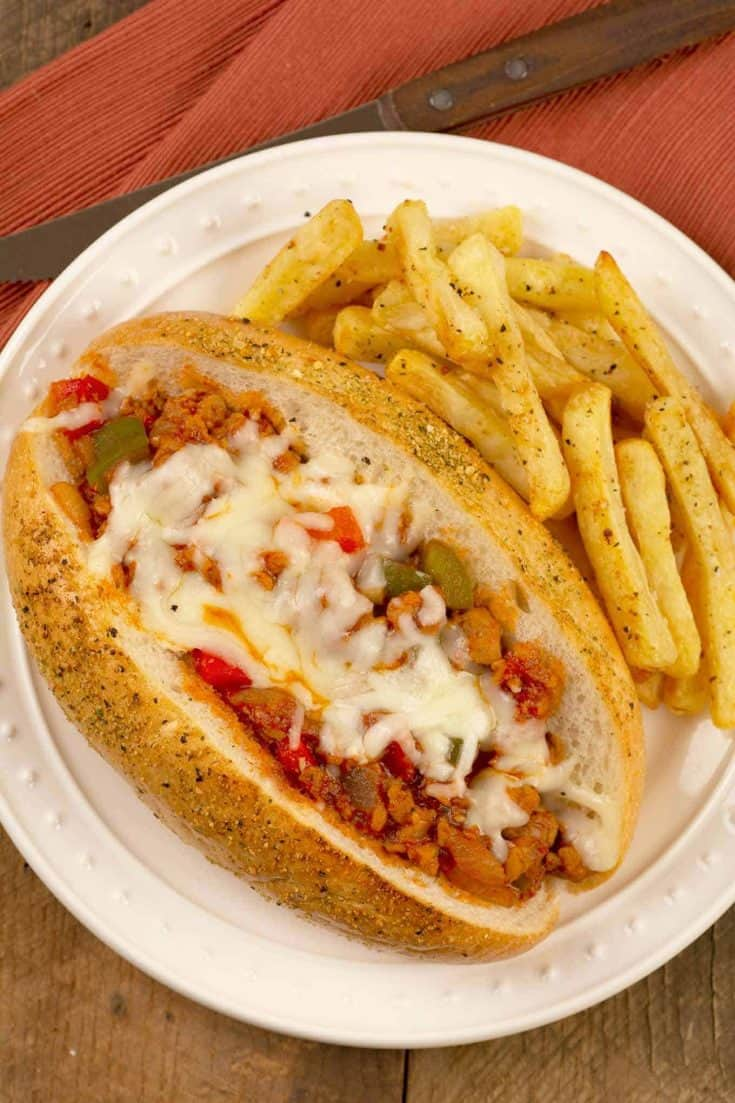 Made with sausage, peppers, marinara and mozzarella, our Italian Sloppy Joes are a delicious twist on the classic American version of this iconic sandwich. #sloppyjoes #italiansub #sausage