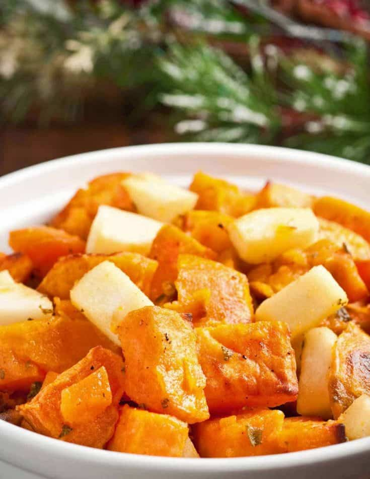 This is an easy side dish of roasted sweet potatoes combined with tart Granny Smith apples, fragrant fresh sage and lemon zest. #sweetpotatocasserole #sweetpotatoes #sweetpotatosidedish