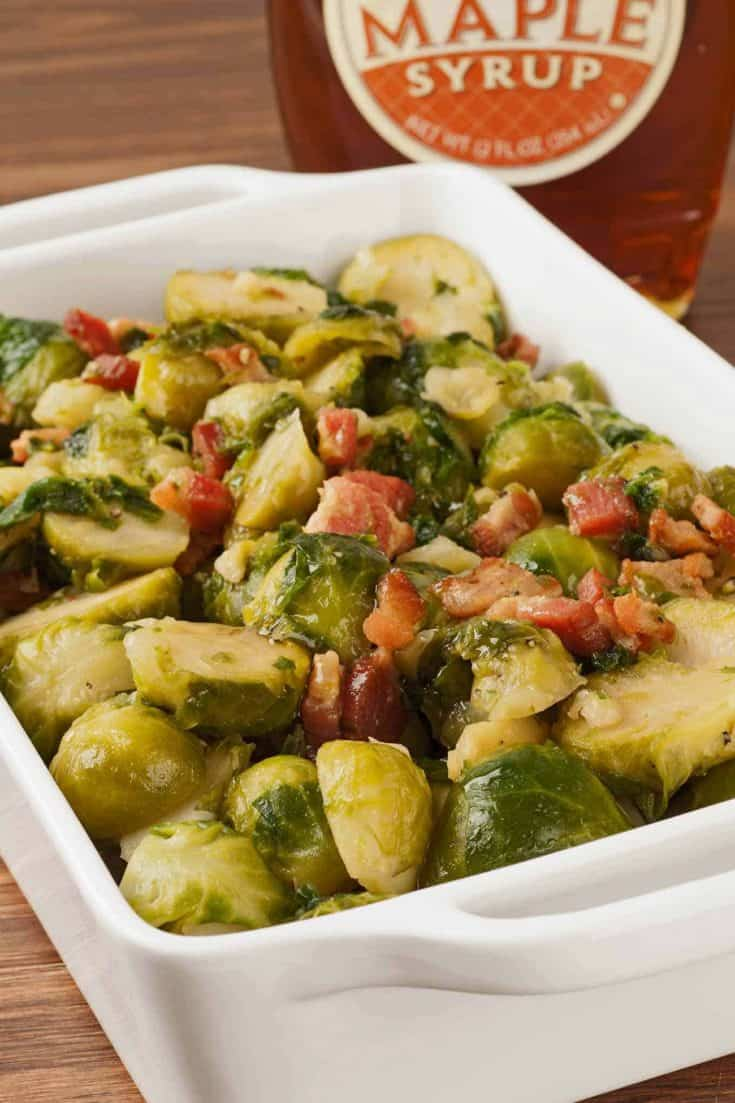 Fresh brussels sprouts glazed with maple syrup and tossed with sauteed onion and bacon are a time tested family favorite. #brusselssprouts #maplebrusselssprouts #brusselssproutsrecipes